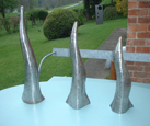 Spouting champagne bottle style water features  for a show garden at RHS Tatton Park Garden Show